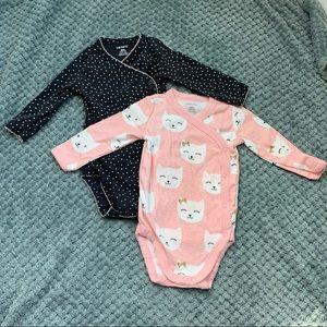 Set of Carter's long sleeve onesies.
